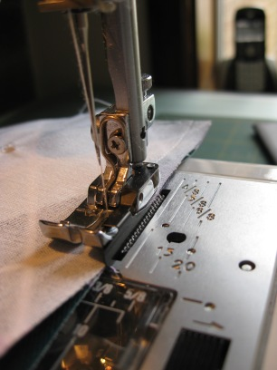 Sewing up the pouches - I have a quarter inch seam foot on my machine in this photo, don't stress if you don't have one, just mark out where quarter inch comes to in relation to your needle and sew parallel to that.
